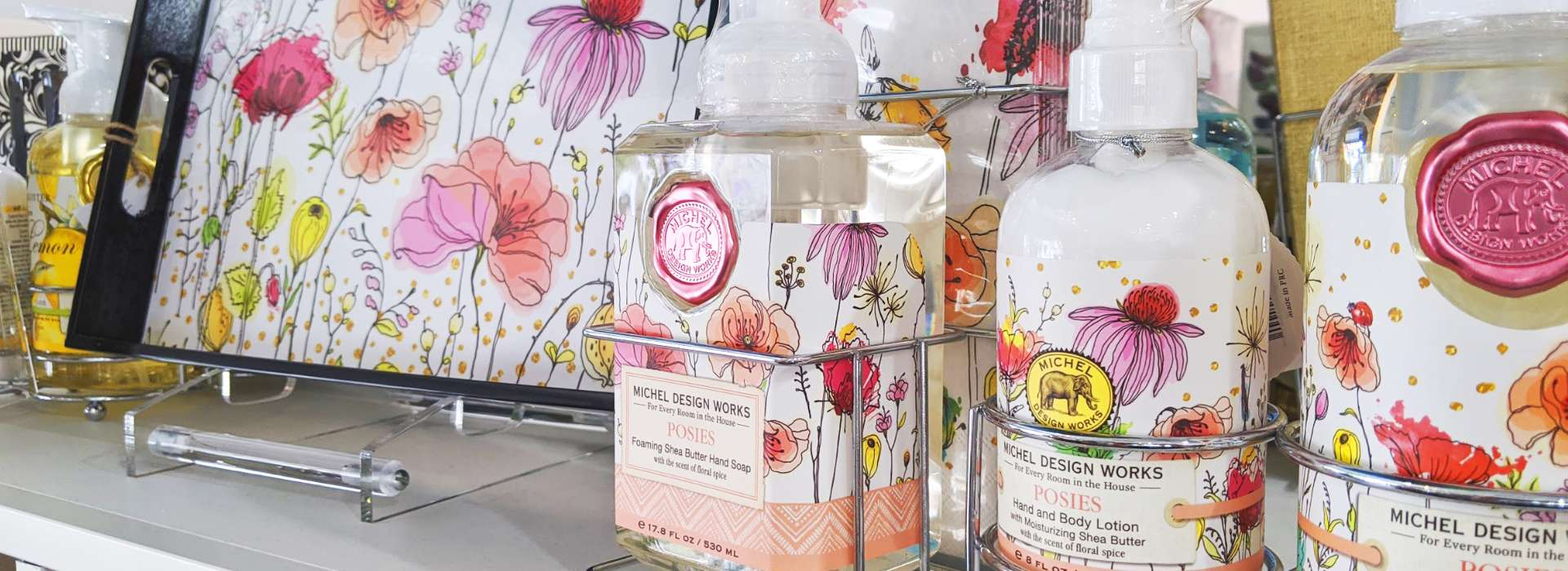 Selection of Michel Design Posies lotions and soap bottles