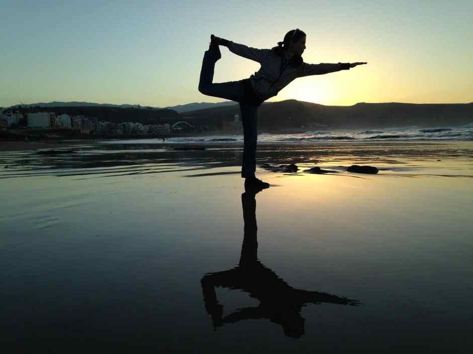 woman doing yoga balance move