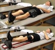 man laying down doing hyperextension exercises