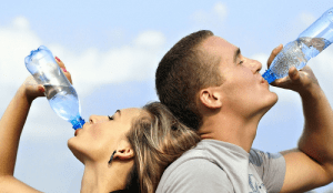 man and woman drinking water