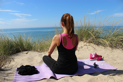 Yoga sitting at the beach
