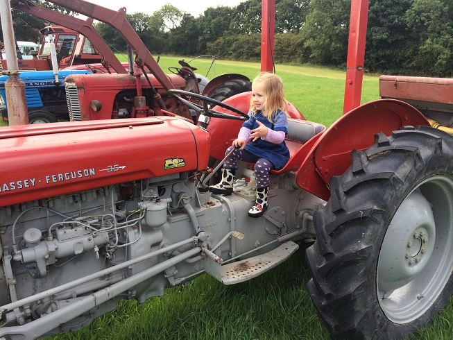 P on tractor at scarecrow festival.