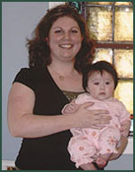 Libby holds Olivia during a recent visit to our office.