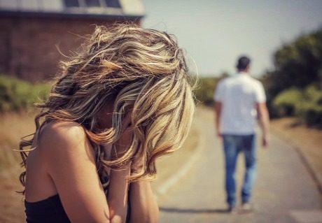 sad woman cries as man walks away
