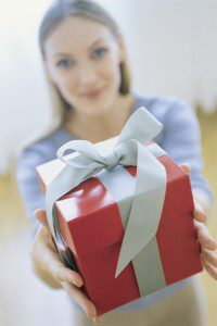 woman presenting a gift