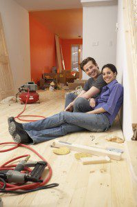 couple take a break in their remodeling project