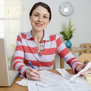 woman working on paperwork for her taxes