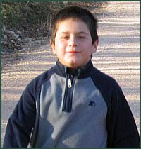 young boy poses for camera