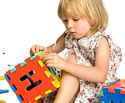 young Russian girl playing with blocks