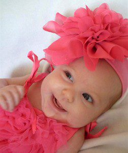 baby dressed in pink hat and top