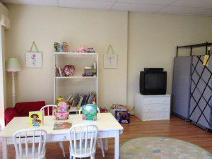 nursery with books for children on open adoption