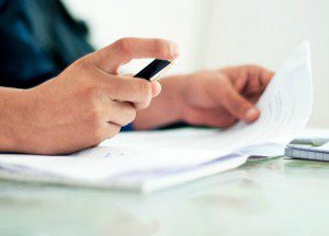 adult signing a financial contract