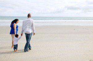 Florida couple stroll on the beach