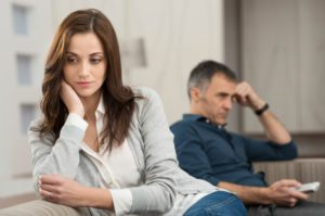 depressed couple looking away from each other
