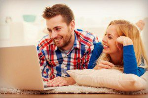 couple designing together on a laptop