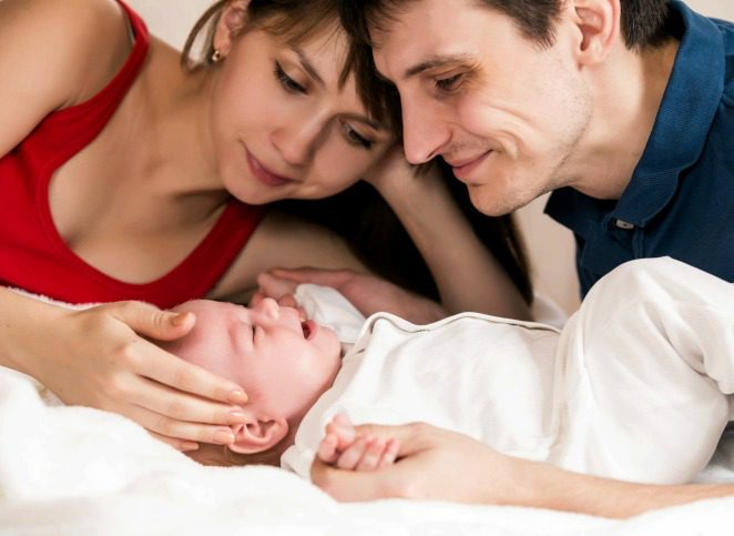 parents look at their happy infant