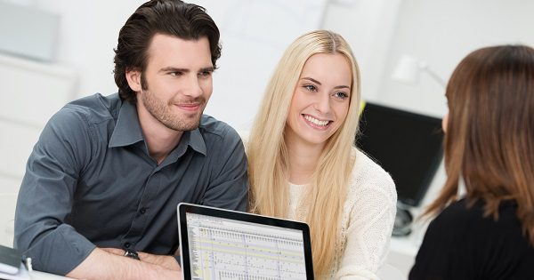 couple with laptop smiling