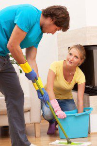 couple cleaning floor together