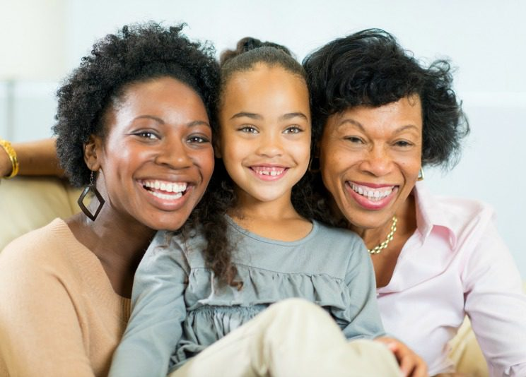 Portrait of a adoptive grandmother, birth mom and granddaughter