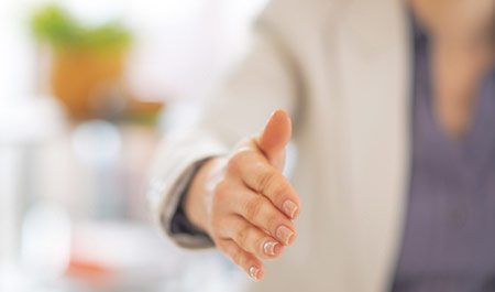 Businesswoman extended her right hand for a handshake