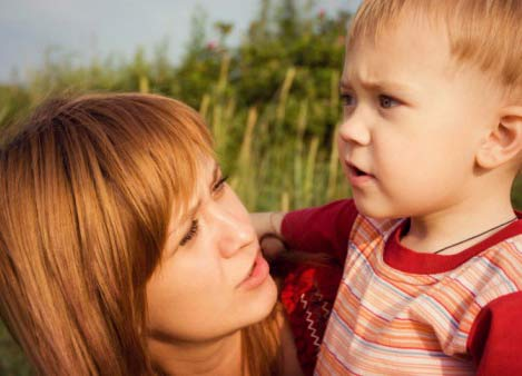 Young mother talks to her toddler son