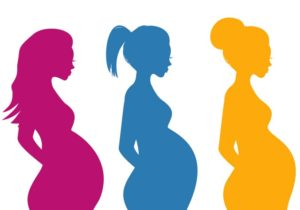 Cartoon silhouette of three pregnant women