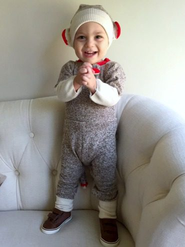 Adorable baby Caden in a sock monkey costume