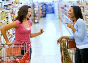 Hopeful adoptive mother talking with a friend at a grocery store