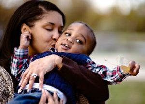 Lifetime adoptive mother Kimberly embraces her son