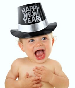 Laughing baby wearing a New Year's hat