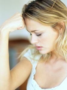 Young blond woman in distress