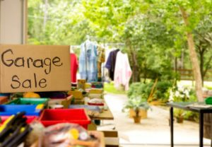 Sign for a garage sale and items for sale at the garage sale