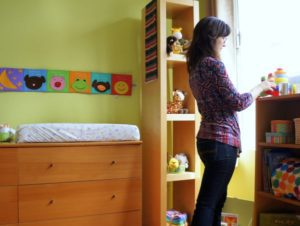 An adoptive mother assembling her future baby's nursery