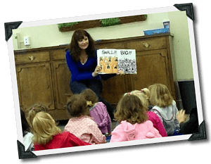 Amanda teaching young children after using her scholarship to get her degree