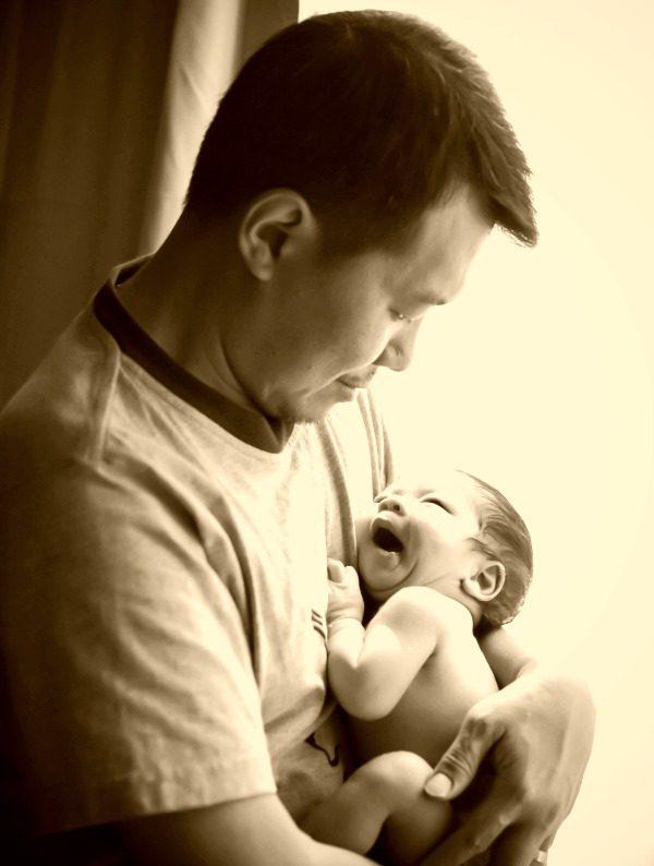 adoptive dad steve and newborn.jpg
