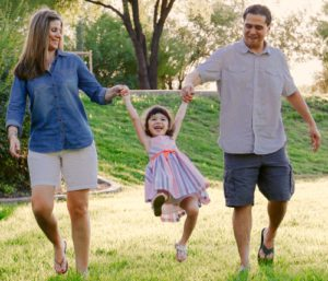 Arizona adoptive couple Laura and Kalen with their daughter