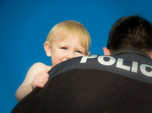 Police officer holding a child