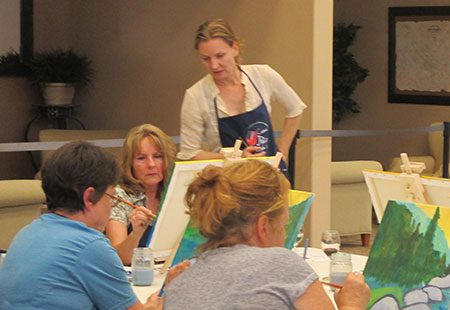 Julia teaching a painting class at Foothills Event Center
