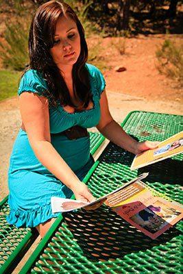 Hispanic Pregnant woman looking at Hispanic adoptive family profiles