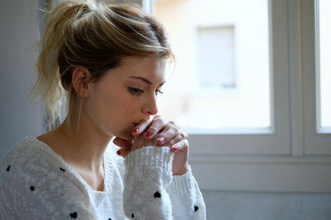 Young mom thinking hard about after-delivery adoption