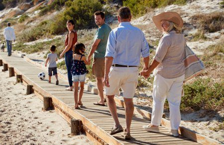 birth family and adoptive family meet to visit at the beach