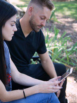 birth parents looking at phone
