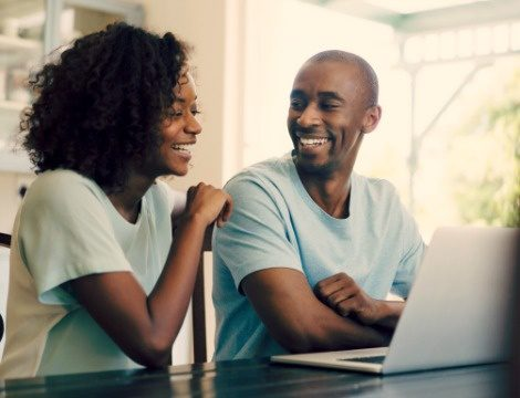 happy couple listen to an adoption webinar