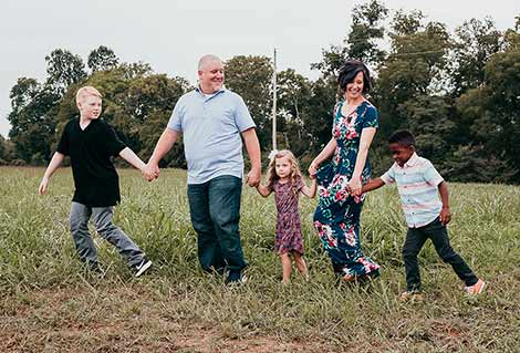 Tami and her husband Dustin with their three children
