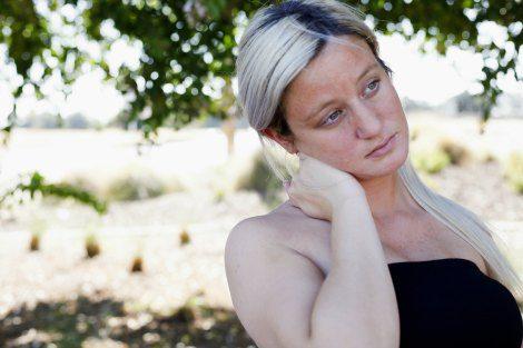 Woman pondering open adoption vs. closed adoption