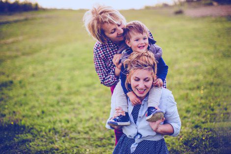 Adoptive mom, child, and birth mother enjoying an open adoption visit