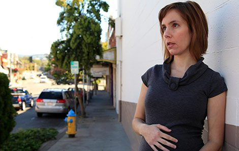 Pregnant woman wondering about the cost of adoption