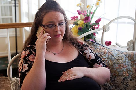 Pregnant woman talks to a peer support counselor about adoption