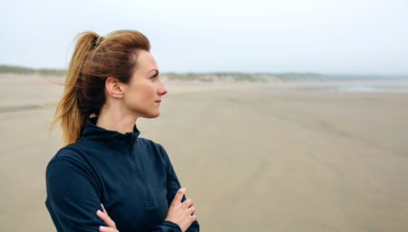Woman on a beach contemplating adoption or abortion