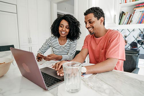 Hopeful adoptive parents researching online how expensive is adoption